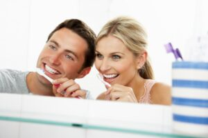 Couple Brushing Teeth | Los Algodones Dentists